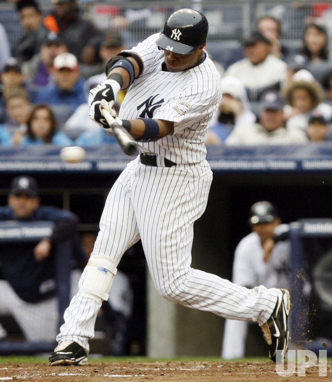 New York Yankees Robinson Cano hits a single in second inning against the Boston Red Sox at Yankee Stadium in New York