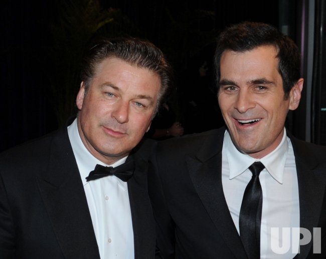 Alec Baldwin (L) and Ty Burrell arrive at the White House Correspondents Dinner in Washington