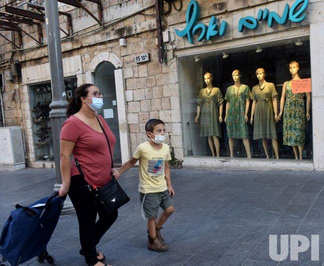 Israelis Wear Protective Masks in Jerusalem