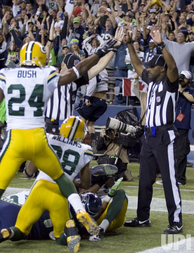 Referee Derrick Rhone Dunn signals a Seattle Seahawks touchdown against the Green Bay Packers' at CenturyLink Field in Seattle.