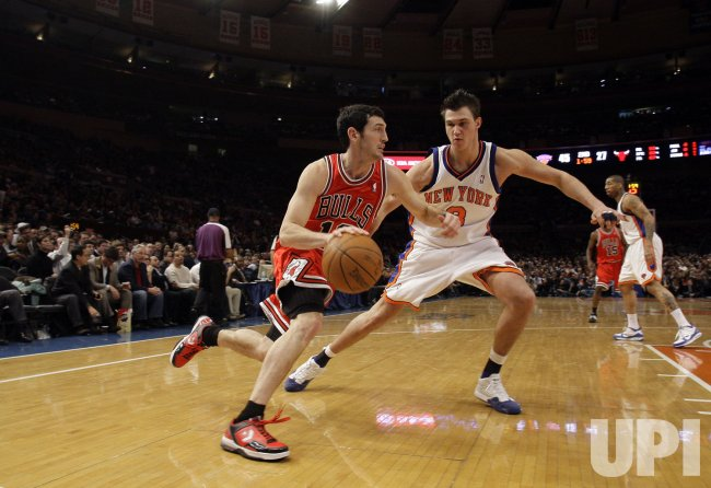 New York Knicks Danilo Gallinari defends Chicago Bulls Kirk Hinrich at Madison Square Garden in New York