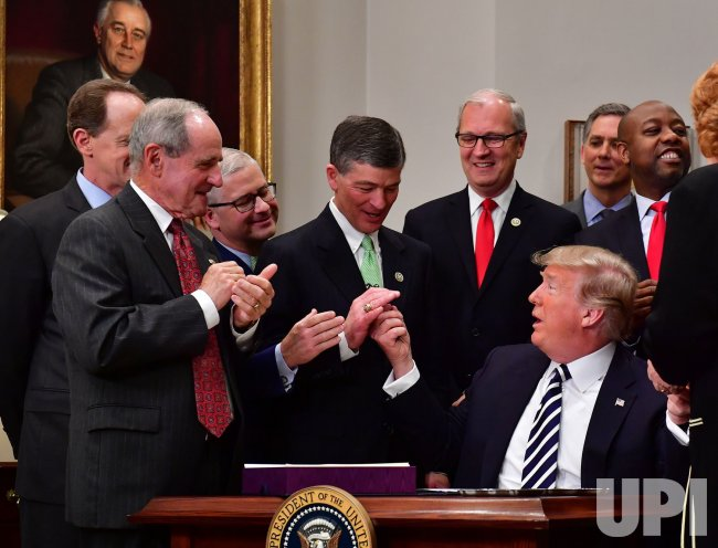 President Trump hands out pens after signing S. 2155 - Economic Growth, Regulatory Relief, and Consumer Protection Act