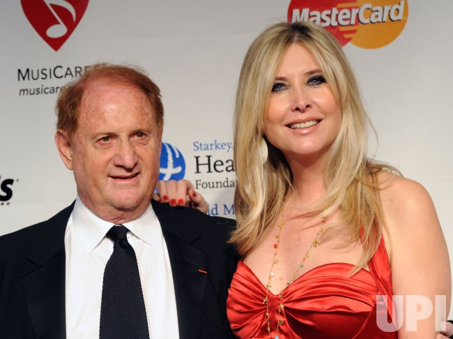 Mike Medavoy and Irena Ferris arrive at MusiCares Person of the Year tribute in Los Angeles