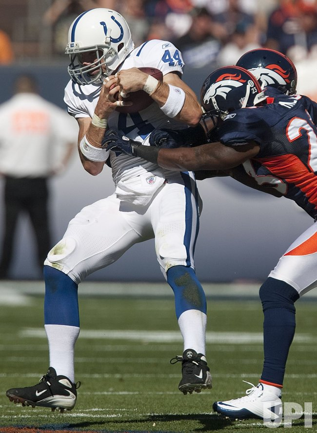 Colts Tight End Clark Makes a Catch Against the Broncos in Denver