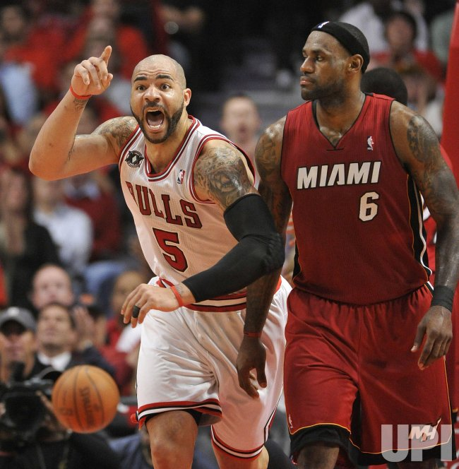 Bulls' Boozer runs by Heat's James in Chicago