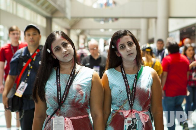 Costumed Comic-Con attendees gather in San Diego