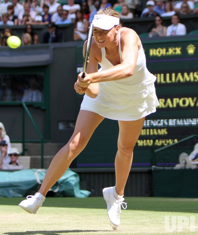 Maria Sharapova plays a backhand at the Wimbledon Championships