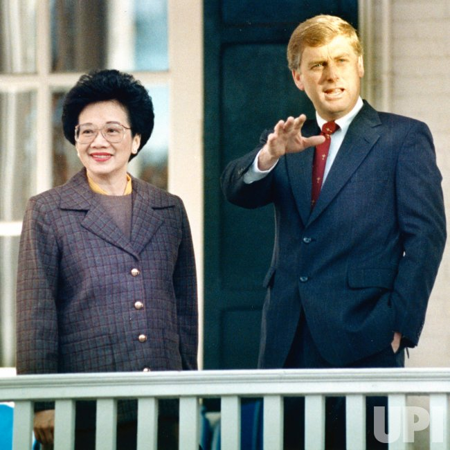 Philippine President Corazon Aquino stands with U.S. Vice President Dan Quayle
