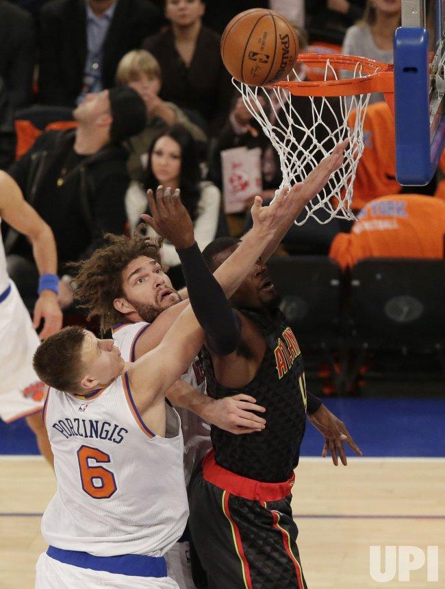 Knicks Lopez and Porzingis defend Hawks Paul Millsap