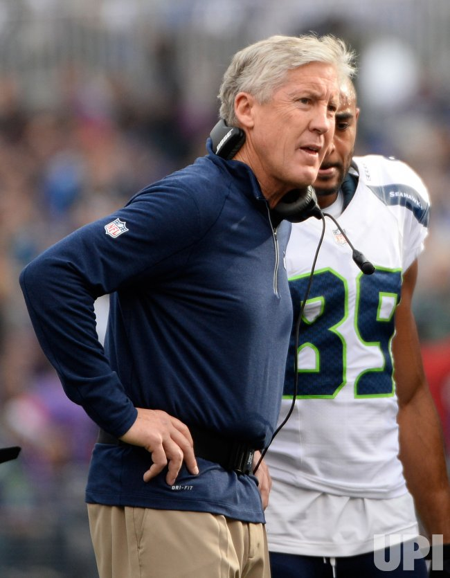Pete Carroll looks on after Thomas Rawls was shaken up