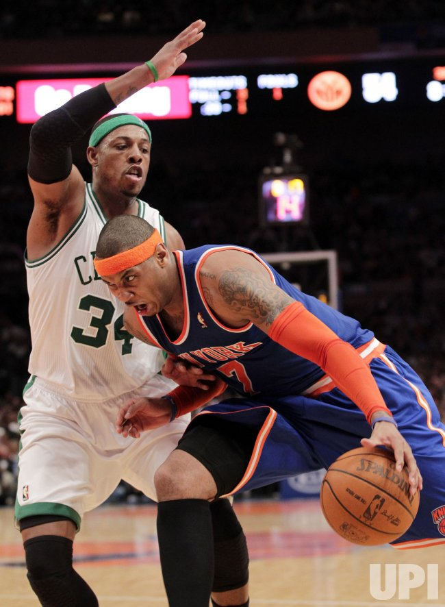 New York Knicks Carmelo Anthony drives by Boston Celtics Paul Pierce at Madison Square Garden in New York