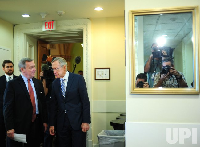 Senate Majority Leader Harry Reid and Assistant Majority Leader Richard Durbin talk in Washington