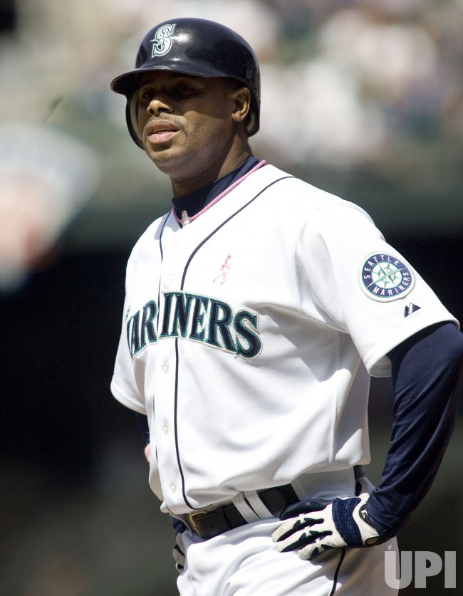 Seattle Mariners' Ken Griffey, Jr., waits at first base after being walked against the Los Angeles Angels.