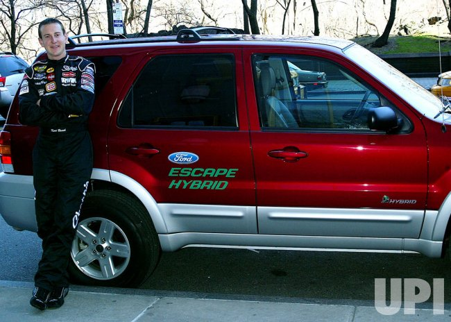 NASCAR DRIVER KURT BUSCH WITH NEW FORD HYBRID CAR