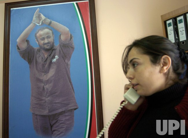 A POSTER OF MARWAN BARGHOUTI HANGS IN HIS IN RAMALLAH OFFICE