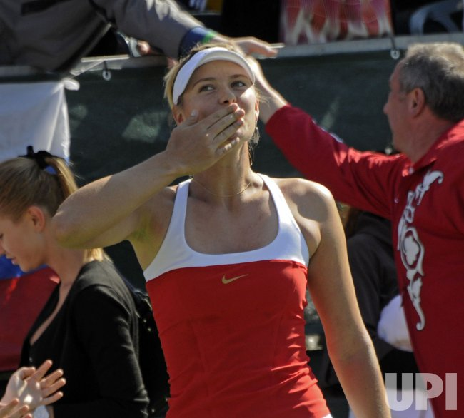 Russia's Maria Sharapova throws a kiss after winning the match against Israel's Shahar Peer in Israel
