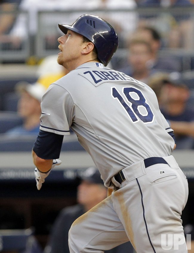 Tampa Bay Rays Ben Zobrist hits a solo home run at Yankee Stadium in New York