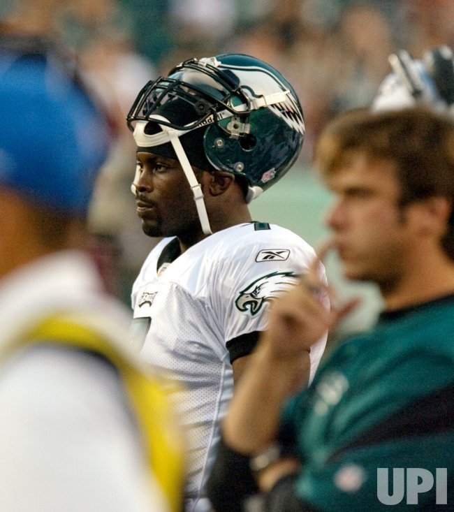 Michael Vick watches from the sidelines