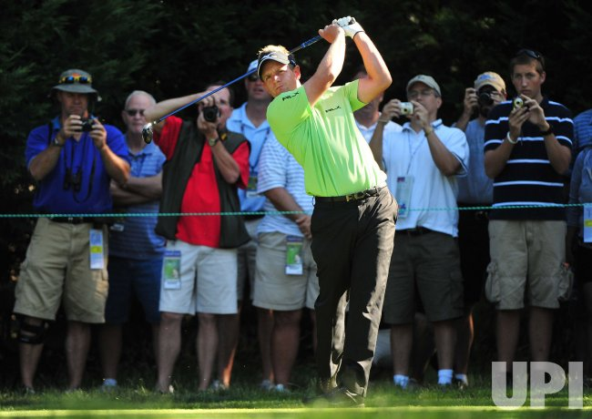 Luke Donald of England hits off of the 7th tee box during a practice round at the US Open in Maryland