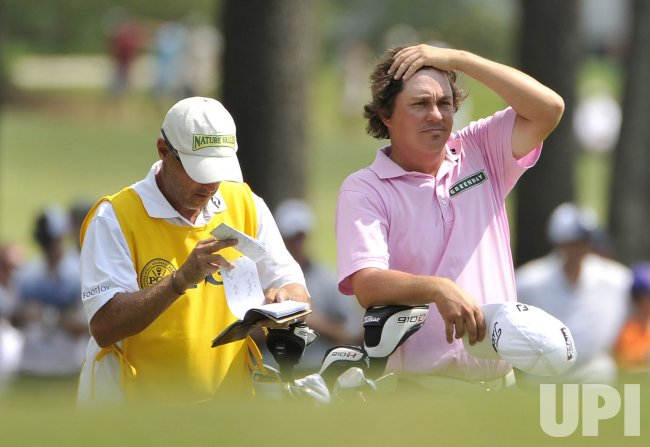 Dufner and Baile stand on 5th fairway at 93rd PGA Championship