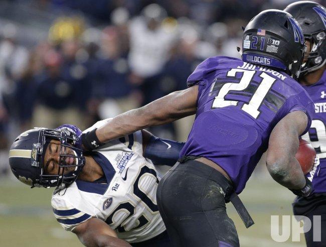 Northwestern Justin Jackson stiff arms Pittsburgh Dennis Briggs