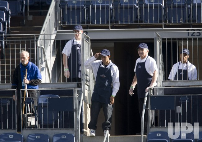 Invesco Field Concession Workers Watch as Broncos QB Orton Works Out for Broncos Coaches in Denver