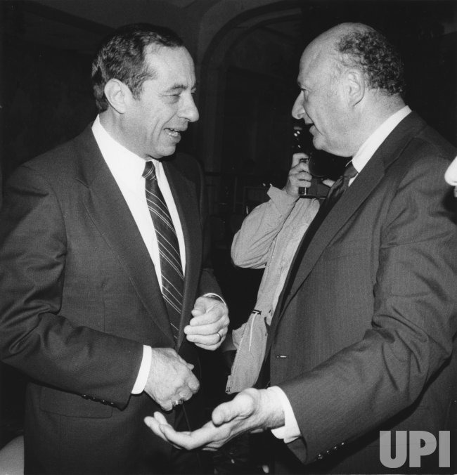 New York Governor Mario Cuomo talks with New York City Mayor Edward Koch