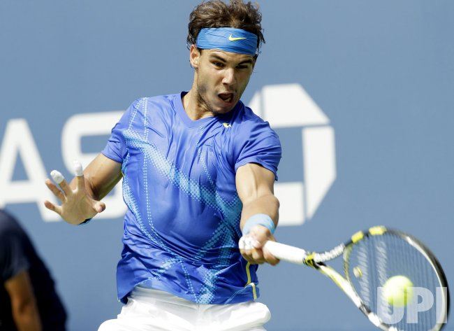 Gilles Muller and Rafael Nadal compete at the U.S. Open in New York
