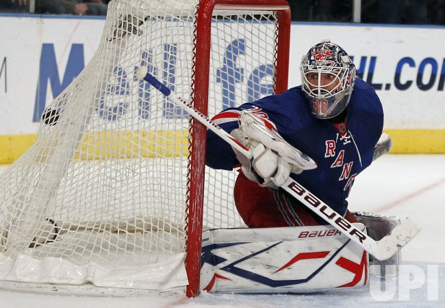 New York Rangers Henrik Lundqvist watches the puck in the net at Madison Square Garden