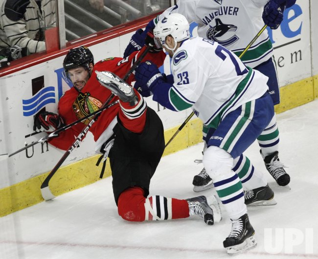Canucks Edler checks Blackhawks Keith in Chicago