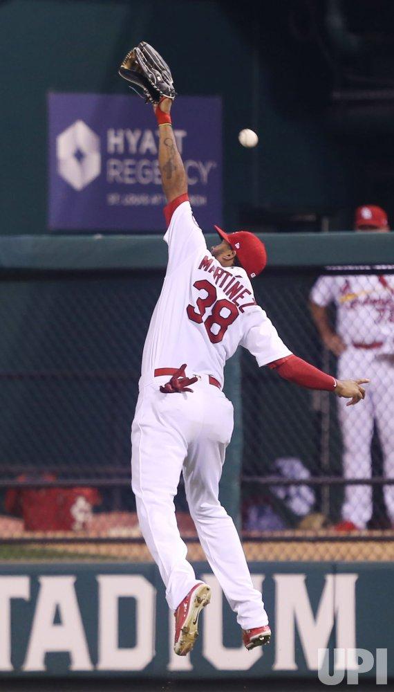 St. Louis Cardinals Jose Martinez misses catch