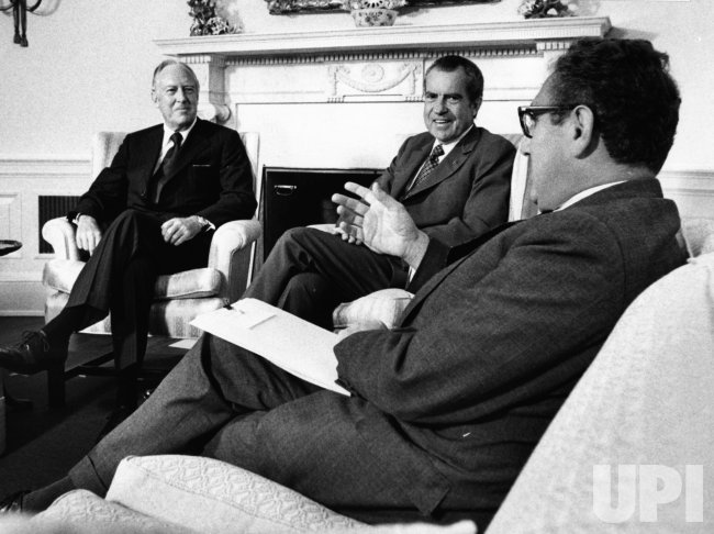 Pres. Nixon meets with William Rogers and Henry Kissinger to discuss their planned foreign trips