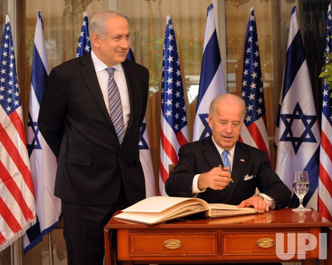 US Vice President Joe Biden signs the guestbook at Israeli Prime Minister Benjamin Netanyahu's residence in Jerusalem