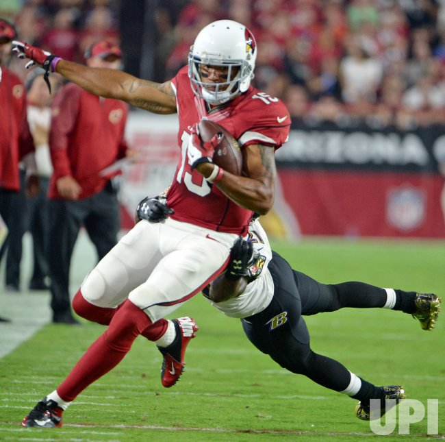 Cardinals Floyd heads for a first down