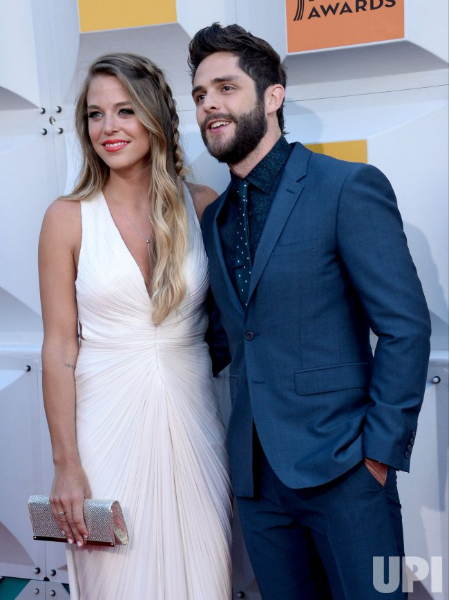 Lauren Gregory And Thomas Rhett Attend The 51st Annual Academy Of