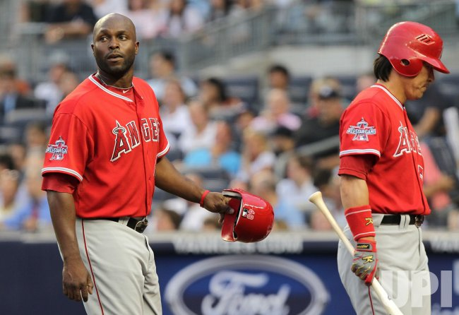 Los Angeles Angels Hideki Matsui and Torii Hunter walk back to the dug out at Yankees Stadium in New York