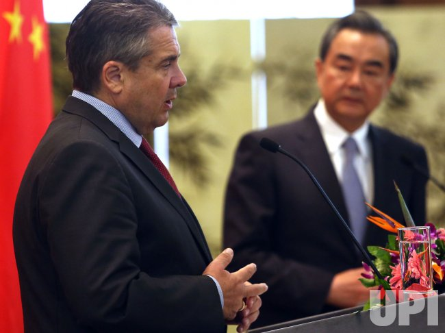 Wang and Gabriel hold a press conference in Beijing, China