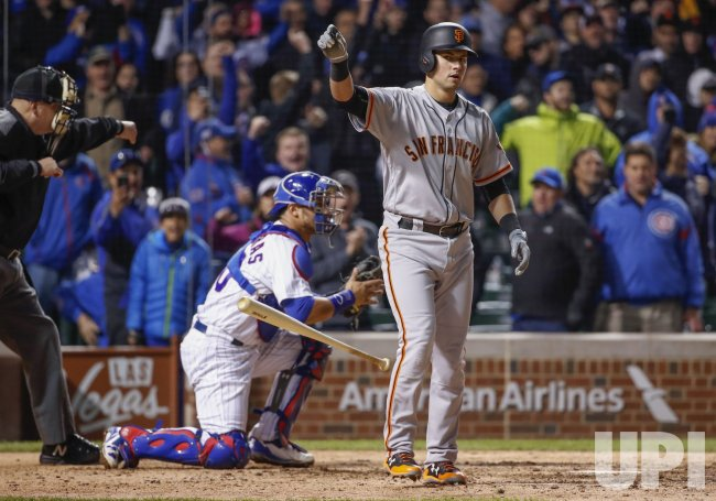 Giants Joe Panik reacts after striking against the Cubs in Chicago