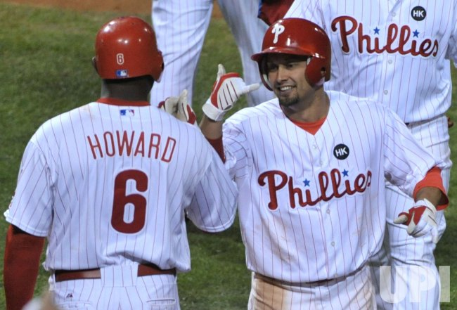 Philadelphia's Shane Victorino celebrates with Ryan Howard during game three of the NLCS in Philadelphia