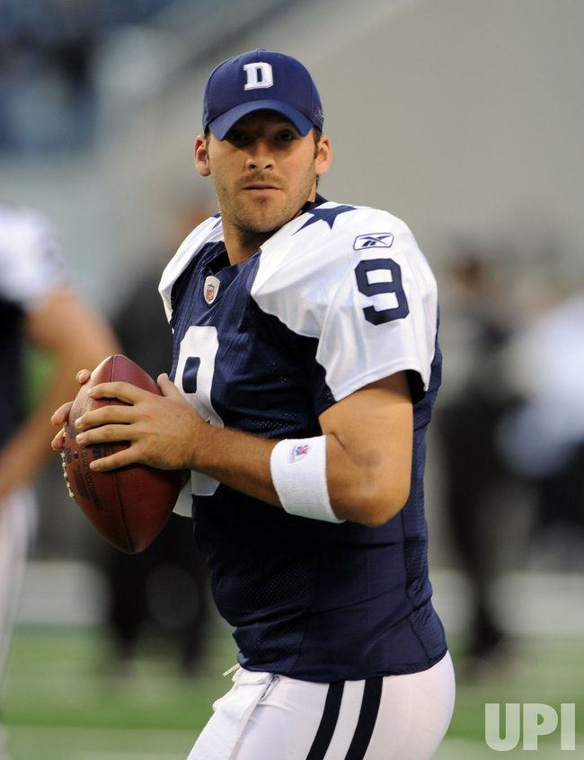 Dallas Cowboys quarterback Tony Romo warms up in Texas