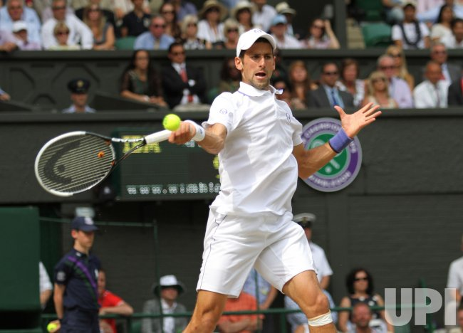Novak Djokovic returns in the Mens Singles Final at Wimbledon.