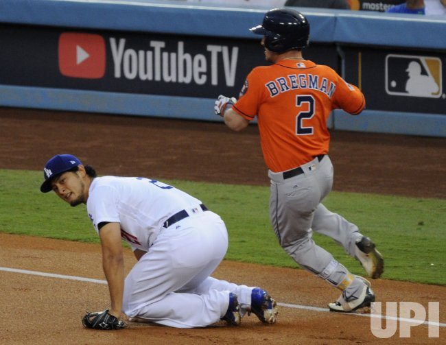 Astros Bregman safe on throwing error by Dodgers in the World Series