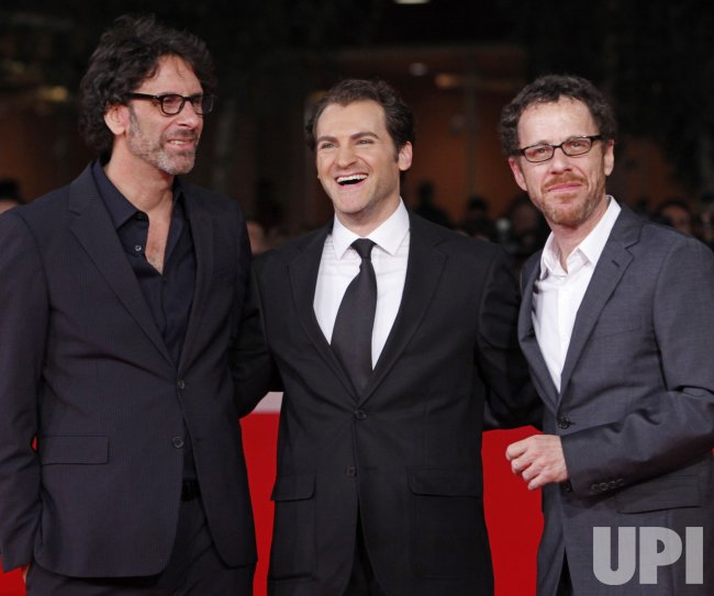 Michael Stuhlbarg and the Coen brothers arrive at the Rome International Film Festival