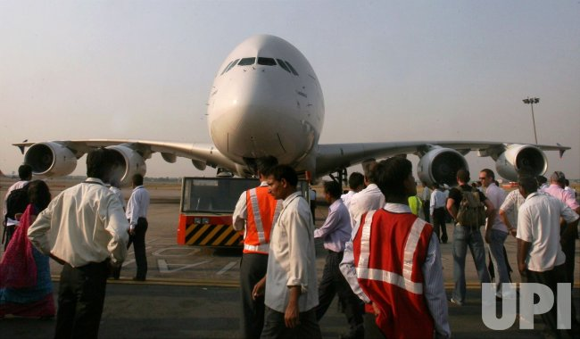 PEOPLE ADMIRE AN AIRBUS A380, AT AIRPORT IN NEW DELHI