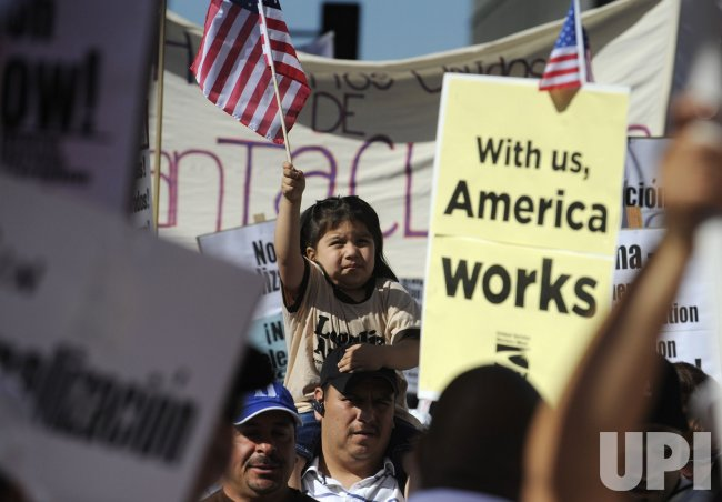 Thousands turn out for a May Day march and rally in support of immigrant rights in Los Angeles