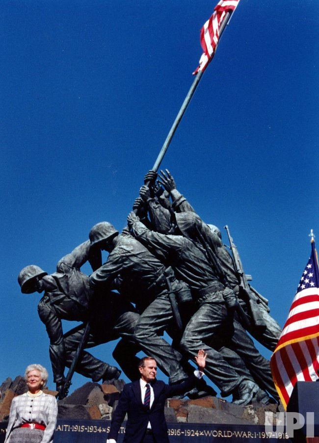 President and Mrs. Bush stand at the base of the Iwo Jima Memorial.