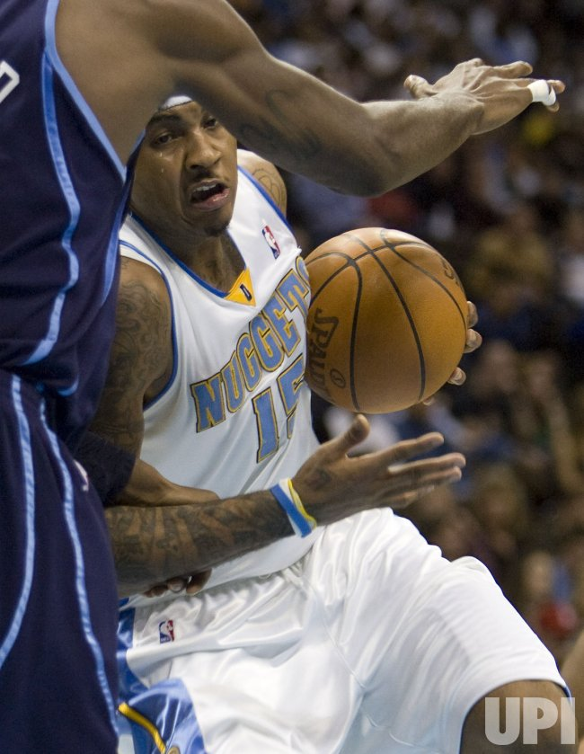 Nuggets Anthony Drives Against Jazz in Denver