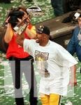 Green Bay Packers Reggie White parades the Vince Lombardi trophy