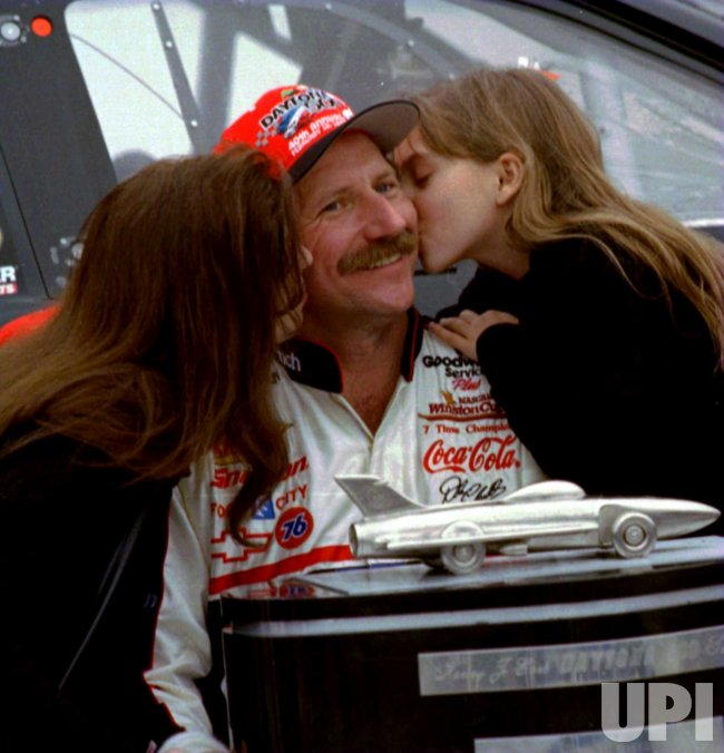 Dale Earnhardt, winner of the 40th annual Daytona 500, gets a kiss of congratulations from family