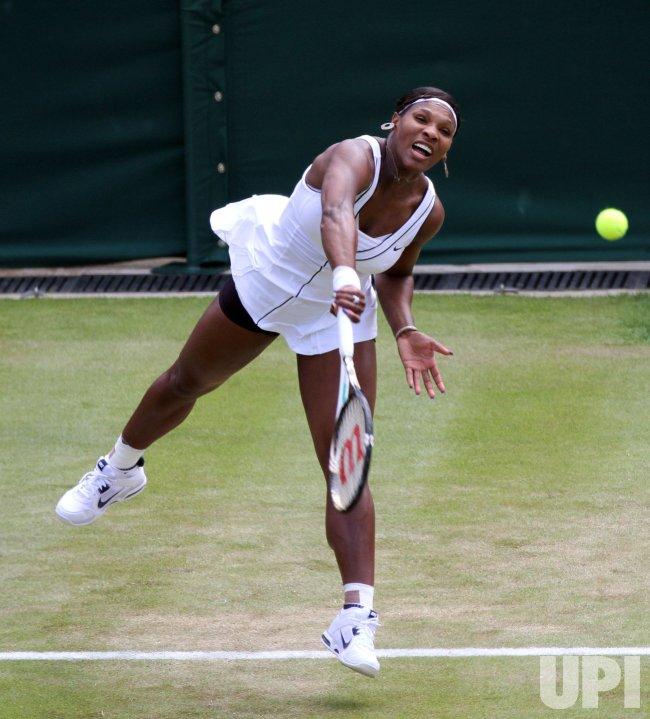 Serena Williams serves at Wimbledon.